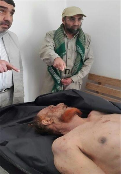 سردار ایرانی بالای سر جنازه معاون صدام+عکس